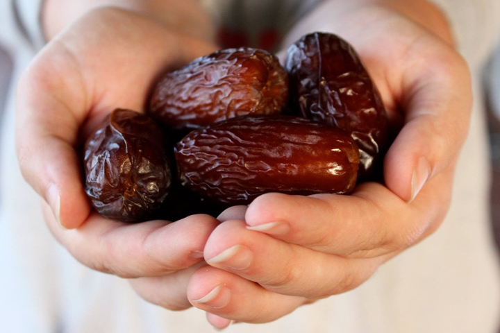Dates in hand