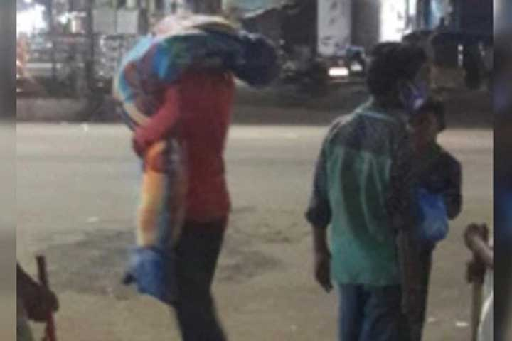 man carries wifes body on shoulder to burial ground in telangana