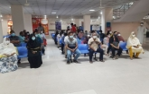 People gather at hospitals to get Pfizer shots